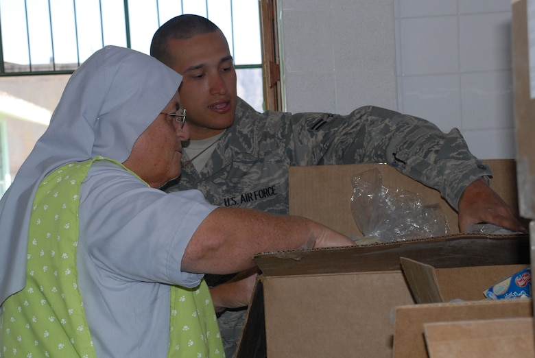 Airman 1st Class George Monroe, deployed from Tinker Air Force Base, Okla., shows Sister Amanda Delgado the types of food donated by U.S. servicemembers, June 9, to Juan Andres Vivanco Amorin, a children's orphanage in Ayacucho, Peru. The orphanage houses 180 boys and girls who will be affected by the support given to New Horizons Peru 2008, a Peruvian and U.S. partnered effort to build schools, clinics, and wells for the Peruvian people. (U.S. Air Force photo/Airman 1st Class Tracie Forte)