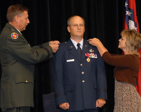 Maj. Gen. William Wofford, Arkansas' adjutant general, and Glo Balch pin brigadier general insignia onto Brig. Gen. Travis D. Balch's uniform at a June 8 ceremony at Camp Joseph T. Robinson in North Little Rock. General Balch is the Arkansas Air National Guard's chief of staff. He is a command pilot with more than 4,500 flying hours in commercial, trainer, tanker and airlift aircraft. (Photo by Master Sgt. Dianna Seerey)