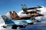 A flight of Aggressor F-15 Eagles and F-16 Fighting Falcons fly in formation, June 5, 2008, over the Nevada Test and Training Ranges. The jets are assigned to the 64th and 65th Aggressor squadrons at Nellis Air Force Base, Nev.