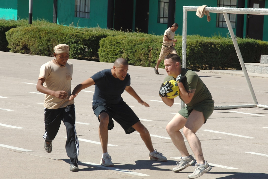 U.S. Airman George Monroe and U.S. Marine Travis Novack, assigned to Task Force New Horizons Peru, play defense in a soccer game, June 8, with Peruvian soldiers during New Horizons Peru 2008, a U.S. and Peruvian partnered humanitarian mission set on improving the quality of life for underprivileged Peruvians. (U.S. Air Force photo/Tech. Sgt. Kerry Jackson)