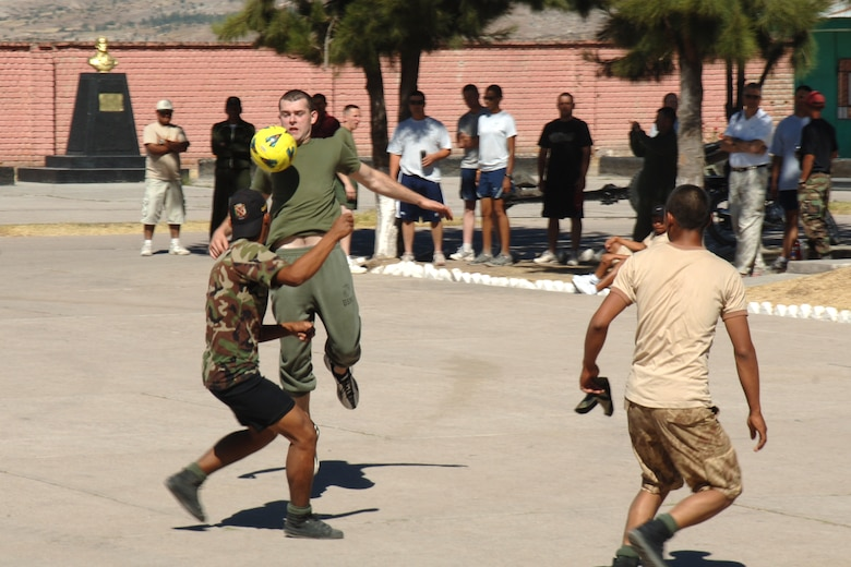 U.S. Marine Lance Cpl. Justin Kittz, assigned to Task Force New Horizons-Peru, traps a ball with his chest while playing a game of soccer, June 8 , with Peruvian soldiers during New Horizons Peru 2008, a humanitarian mission set on improving the quality of life for underprivileged Peruvian.  (photo by: U.S. Air Force Tech. Sgt. Kerry Jackson)