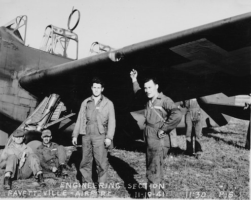 Maryland Guardsmen of the 104th Observation Squadron's Engineering Section take a break under the wing of one of the squadron's O-47 aircraft during training at Fayetteville Airport, N.C., Nov. 19, 1941. The unit, along with the rest of the Maryland National Guard, had been mobilized in February in anticipation of World War II.