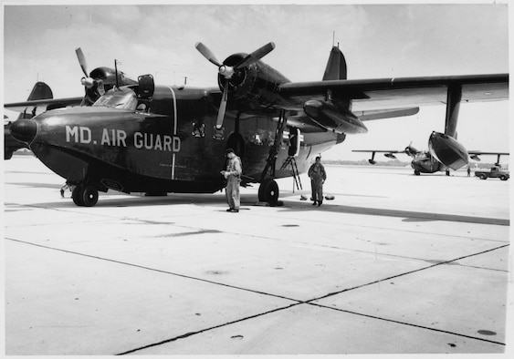 "Aircrew assigned to the Maryland Air National Guard's 135th Air Commando Squadron prepare an HU-16 ""Albatross"" for flight. The aircraft is painted black to facilitate covert night operations. The Maryland Air National Guard was equipped with HU-16s from 1956 to 1971."