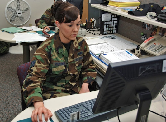 Staff Sgt. Julie Stephenson works on one of her many computer-related duties during the May Unit Training Assembly. Sergeant Stephenson, an information manager for the 931st Military Support Flight, receives tuition assistance from the Air Force while working on a bachelor's degree at Wichita State University in Wichita, Kan. (U.S. Air Force photo/Tech. Sgt. Jason Schaap)