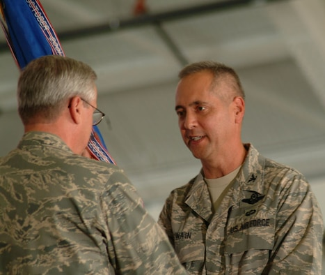 Col. Robert R. Swain Jr. assumes command of the 439th Airlift Wing with Maj. Gen. Martin M. Mazick, 22nd Air Force commander, during the wing change of command ceremony June 8. (US Air Force photo/Staff Sgt. Hueming Mui)