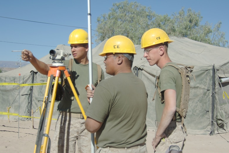 U.S. Marine Lance Cpl. James Wasch assigned to Westover Air Reserve Base, Mass.,  does a site survey, June 6 ,  with fellow Marines for the construction of a new clinic in Yanamilla, Peru in support of New Horizons - Peru 2008, a partnered U.S. and Peruvian humanitarian mission set on improving the quality of life for underpriviledge Peruvians. (U.S. Air Force Photo/ Tech. Sgt. Kerry Jackson)