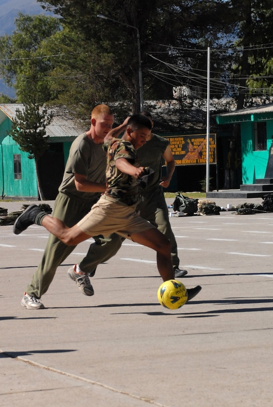 A Peruvian soldier attempts to score a goal against U.S. servicemembers, assigned to Task Force New Horizons, during a soccer game, June 8, on a Peruvian Army base in Ayacucho, Peru, the region benefiting from the humanitarian efforts of New Horizons Peru-2008. New Horizons is a U.S. and Peruvian partnered effort to help underprivileged Peruvians by building schools, clinics, and wells. (U.S. Air Force photo/Airman 1st Class Tracie Forte)