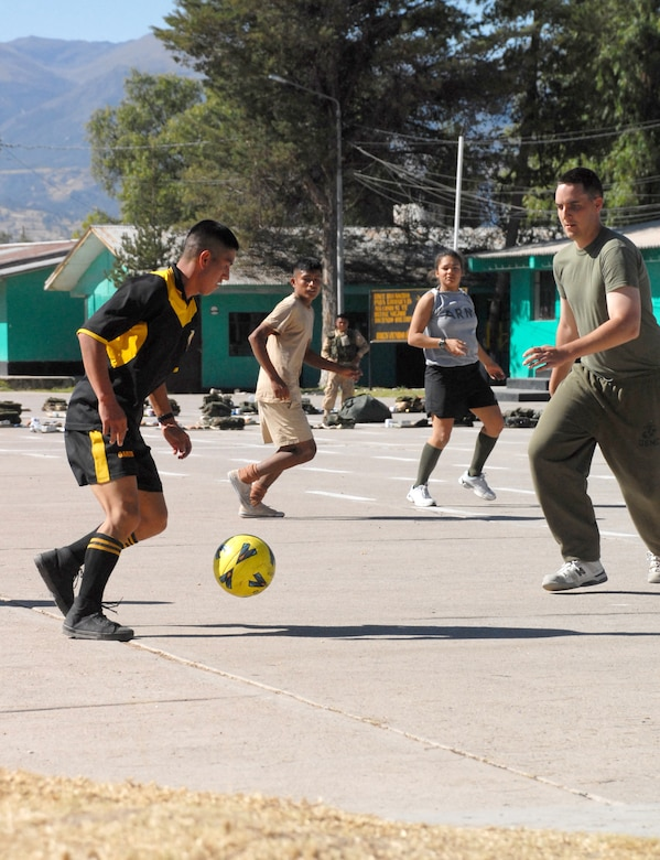 U.S. servicemembers assigned to Task Force New Horizons, and Peruvian soldiers play a game of soccer during their off time, June 8, on a Peruvian Army base in Ayacucho, Peru, the region benefiting from the humanitarian efforts of New Horizons Peru-2008. New Horizons is a U.S. and Peruvian partnered effort to help underprivileged Peruvians by building schools, clinics, and wells. (U.S. Air Force photo/Airman 1st Class Tracie Forte)