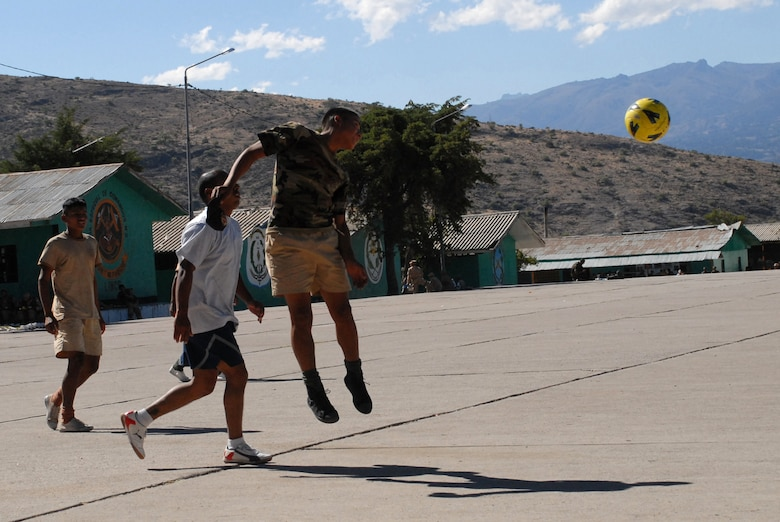 A Peruvian soldier heads the ball during a soccer game against U.S. servicemembers assigned to Task Force New Horizons, June 8, on a Peruvian Army base in Ayacucho, Peru, the region benefiting from the humanitarian efforts of New Horizons Peru-2008. New Horizons is a U.S. and Peruvian partnered effort to help underprivileged Peruvians by building schools, clinics, and wells. (U.S. Air Force photo/Airman 1st Class Tracie Forte)
