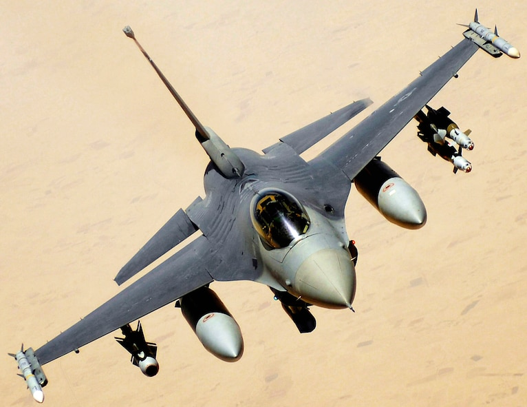 An F-16 Fighting Falcon aircraft returns to the fight after receiving fuel June 10 during a mission over Iraq. The F-16 is assigned to Balad Air Base, Iraq, and is deployed from Hill Air Force Base, Utah. (U.S. Air Force photo/Master Sgt. Andy Dunaway)