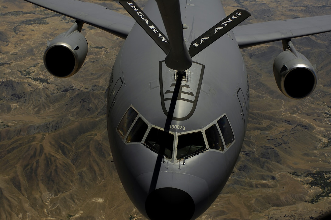 A KC-10 Extender moves into position to receive fuel from a KC-135 Stratotanker during a mission over Afghanistan. The KC-10 is deployed from McGuire Air Force Base, N.J.,  and the KC-135 is deployed from the 174th Air Refueling Squadron from Sioux City, Iowa.(U.S. Air Force photo/Master Sgt. Andy Dunaway)
