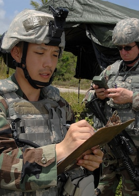 Senior Airman Richard Park (front)  and TSgt Brent Stiefel (back) both from the 18th Security Forces Suadron, Kadena Air Base, Japan, plot points on the range card during PACAF's Commando Warrior on June 14 at Andy South here. During the range card activity fire team members plot substantial terrain trademarks like hills, mountains, and buildings.  Commando Warrior is a seven day pre-deployment training for PACAF's Security Forces airmen hosted by the 736th Security Forces Squadron, Andersen AFB, Guam. (U.S. Air Force photo by Airman 1st Class Nichelle Griffiths)