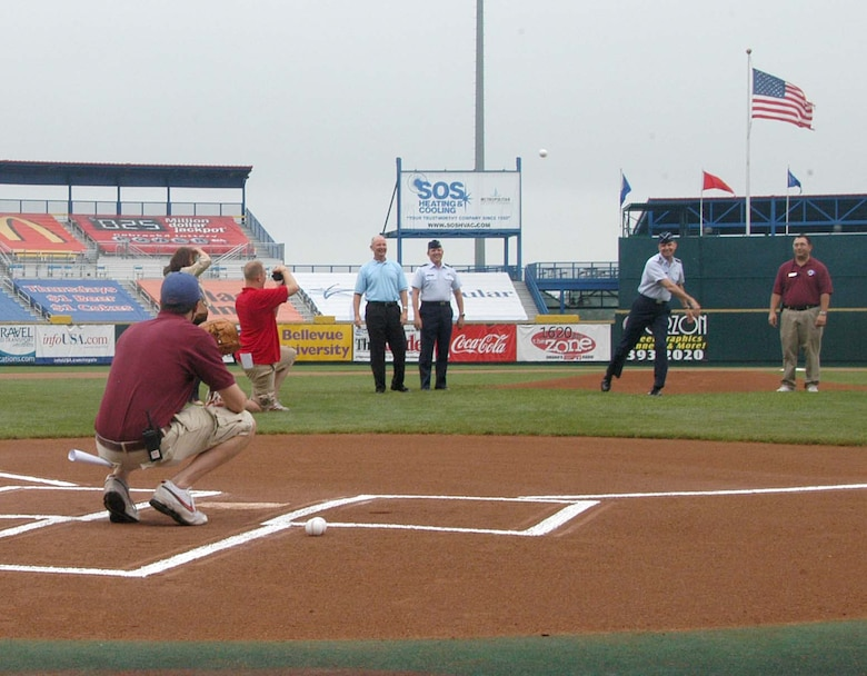 Gen. Kevin Chilton, commander of U.S. Strategic Command, throws the first pitch druing Military Appreciation Day at Rosenblatt Stadium June 8 while Col. Robert Maness, 55th Wing vice commander, waits for his turn on the mound. The annual Military Appreciation Day game featured the Omaha Royals against the Iowa Cubs. (U.S. Air Force Photo By/Jeff Gates)