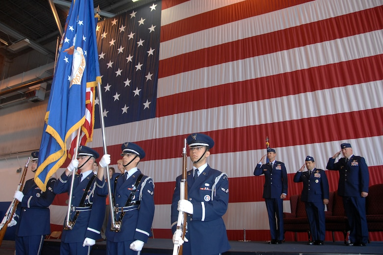 Brig. Gen. James Jones, 55th Wing commander, Col. Phillip Smith and Col. Jeffrey Herd render proper courtesy to the flag at the 55th Operations Group change of command ceremony June 5. Herd assumed command of the Air Combat Command's largest group which has operational control over 12 squadrons and two detachments worldwide and consists of about 3,200 personnel. (U.S. Air Force Photo By/Josh Plueger)