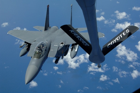 A U.S. Air Force F-15E Strike Eagle from Mountain Home Air Force Base, Idaho, approaches the boom for refueling high above the pacific by a KC-135 Stratotanker from the 117th Air Refueling Squadron, Forbes Field Air National Guard Base, Topeka Kan. Both took off from Andersen Air Force Base, Guam on June 12. (U.S. Air Force photo by Airman 1st Class Courtney Witt)