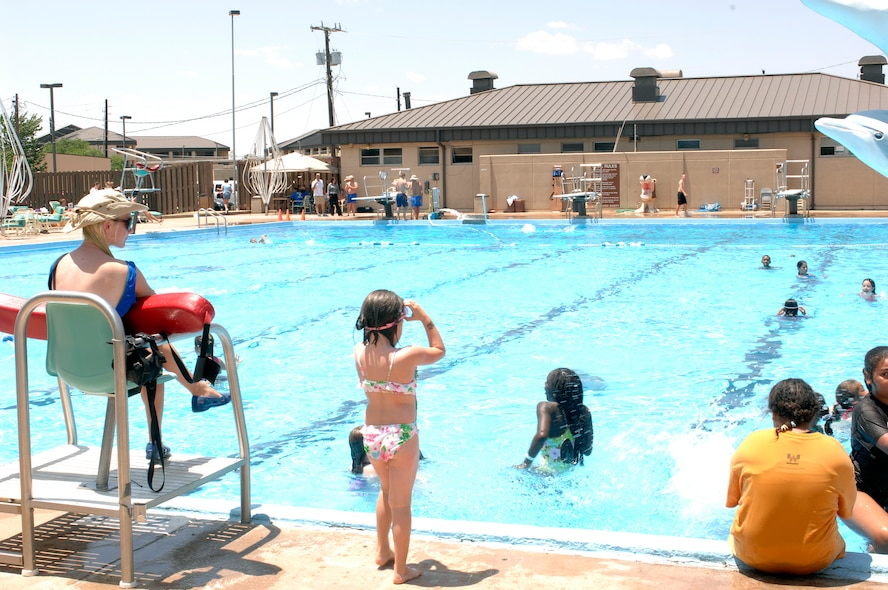 Life Guard, Karissa McClain, keeps watch at the Altus Air Force Base swimming pool, one of the coolest spots for summer fun. (U.S. Air Force/Michael Fletcher)