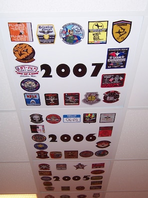 The patches from Specialized Undergraduate Pilot Training classes line the ceiling tiles of the 48th Flying Training Squadron's heritage room for each year of training. (U.S. Air Force photo by Sonic Johnson)