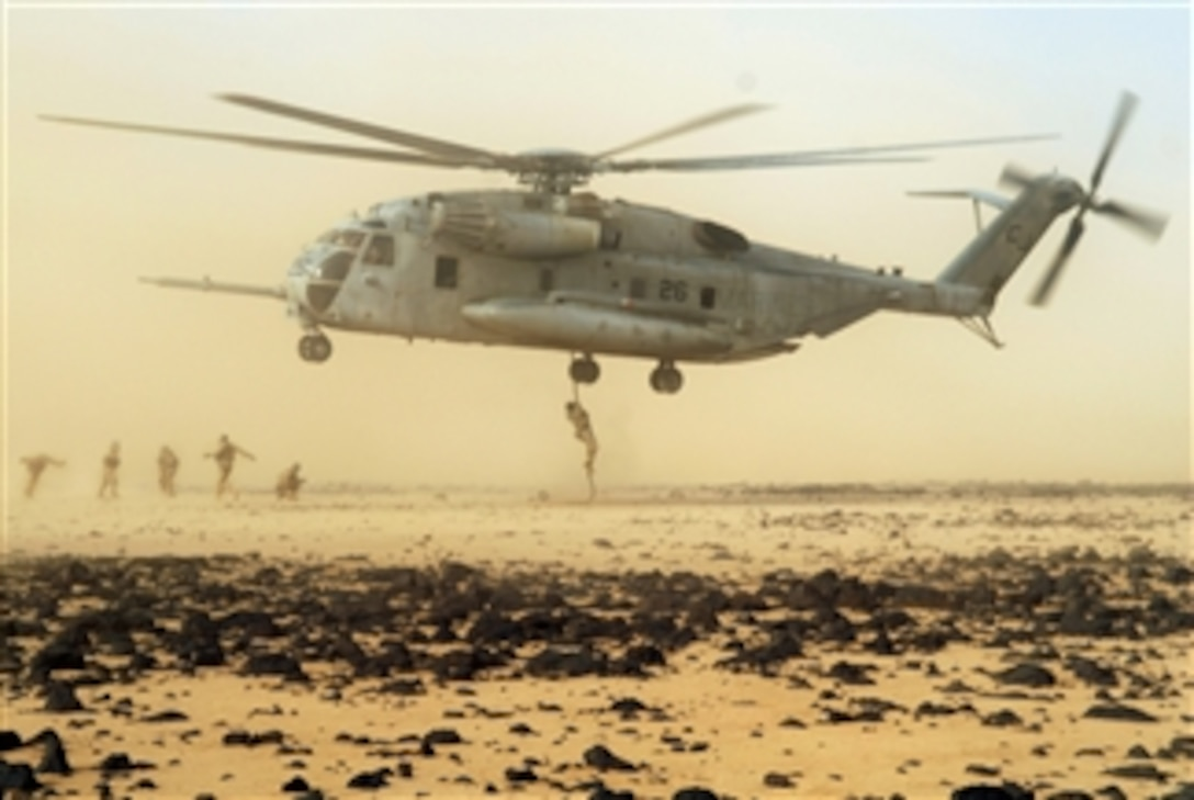 U S  Air Force pararescuemen conduct a fast rope exercise