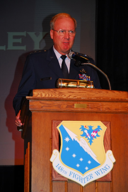 U.S. Air Force Lt Gen Craig McKinley, Director of the Air National Guard presents the 148th Fighter Wing, Duluth, Minn. with the Outstanding Unit Award on June 15, 2008 during an awards ceremony.  The wing received the Outstanding Unit Award for its involvement in multiple deployments in the United States and overseas, high recruiting and retention rates, and exceptional inspection results.  (U.S. Air Force photo by Tech. Sgt. Brett R. Ewald)  (Released)