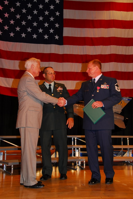 U.S. Air Force Master Sergeant Wayne D. Kettelhut, 148th Fighter Wing Explosive Ordinance (EOD) Specialist, was awarded the Bronze Star Medal with Valor at an awards ceremony in Duluth, Minn. on June 15, 2008.  The award was presented by Major General (retired) Harry J. Sieben (left), Civilian Aide to the Secretary of the Army and Lt Col (retired) Gary Hetrick, US Army who served with MSgt Kettelhut in Iraq during the time he earned his Bronze Star with Valor.  (U.S. Air Force photo by Tech. Sgt. Brett R. Ewald)  (Released)