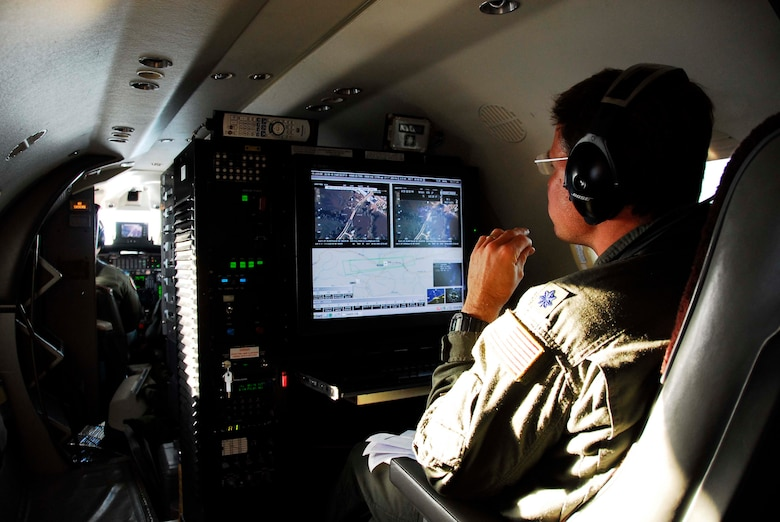 Mission system operator Lt Col Tim Howell from the 186th Air Refueling Wing, Meridian, MS operates a console aboard an RC-26 aircraft specifically designed for viewing and transmitting high quality video and still imagery to military and civilian Operations Centers in real-time.  This capability gives military commanders and civilian first responders a bird's eye view of significant events as they happen.  Working with several state agencies along with the Wisconsin Air National Guard, the Mississippi Air National Guard RC-26 demonstrated the benefits of this new capability during an initial flood assessment mission in southern Wisconsin on June 10th, 2008.  The crew of this RC-26 flew above the flood stricken region transmitting real-time imagery to the Wisconsin Joint Operations Center (JOC) and the Wisconsin Emergency Operations Center (WEOC) in addition to other agencies.  This imagery was used to asses the integrity of several area Dams in addition to flood damage assessment in the hardest hit regions of the southern half of the state.