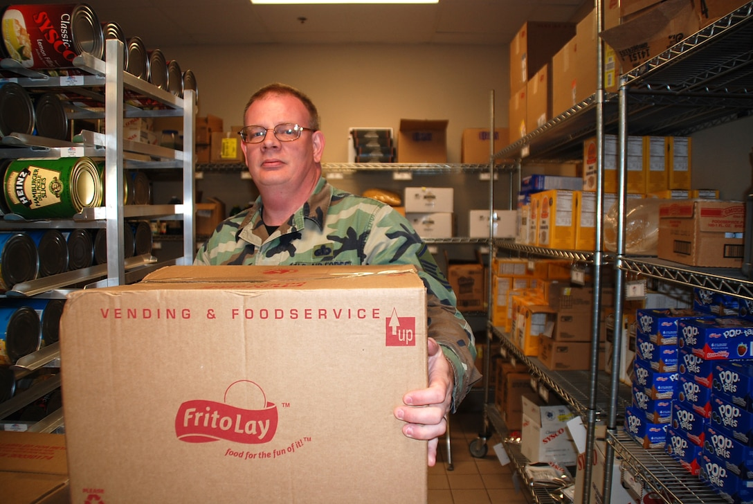 Master Sgt. Edward Updyke works in the storeroom of the Reef Dining Facility at MacDill Air Force Base, Fla., during a deployment there in April 2008.  Sergeant Updyke and other members of the 442nd Services Flight deployed to MacDill AFB for two weeks of annual tour.  The 442nd SVF is part of the 442nd Fighter Wing, an Air Force Reserve unit based at Whiteman AFB, Mo.  (U.S. Air Force photo/Tech. Sgt. Susan Walthour)