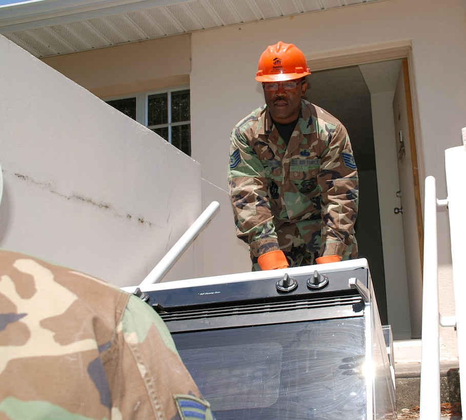 Tech. Sgt. Eddie Norton, who volunteered to work with Habitat for Humanity during a deployment to MacDill Air Force Base, Fla., removes a stove that will be sent to the community service group, which builds houses for those in need.  Sergeant Norton is a member of the 442nd Services Flight, part of the 442nd Fighter Wing, an Air Force Reserve unit based at Whiteman AFB, Mo.  (U.S. Air Force photo/Tech. Sgt. Susan Walthour)