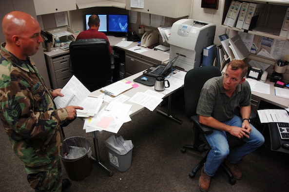 Staff Sgt. Jon Barber (left) asks Tech. Sgt. Ed Cropper about a training-related issue at the 931st Aircraft Maintenance Squadron on June 19.  Sergeant Cropper is the squadron's unit deployment manager and has been busy preparing for participation in an Operational Readiness Inspection and deployments to Turkey that begin next week.  More than 40 AMXS Airmen have volunteered to support an Air Expeditionary Force in Turkey.  Sergeant Barber is an AMXS crew chief.