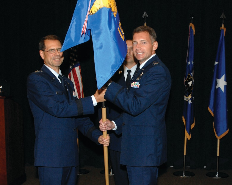 Col. Gary Henry accepts the Launch and Range Systems Wing guidon from AFSPC/SMC Commander, Lt. Gen. John T. 'Tom' Sheridan signifying his acceptance of command as the new commander of AFSPC Space and Missile Systems Center Launch and Range Systems Wing. Colonel Henry, formerly vice commander of the Space Superiority Systems Wing. (photo by Stephen Schester)