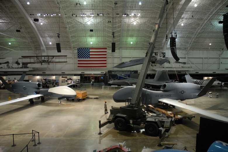 DAYTON, Ohio (05/2008) -- Restoration crews prepare to replace a model of the Global Hawk (right) with the RQ-4 Global Hawk that has seen action in Operation Enduring Freedom (Afghanistan) and in several American and international joint forces exercises. (U.S. Air Force photo)