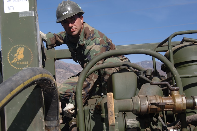 U.S. Navy Petty Officer 2nd Class Paul Larson, a lead welder assigned to Task Force New Horizons, fills a water well rig with fuel, June 19, in Huanta, Peru, where U.S. Navy Seabeas are constructing a water well in support of New Horizons Peru 2008, a U.S. and Peruvian humanitarian mission set on providing relief to underprivileged Peruvian. (U.S. Air Force photo/Tech. Sgt. Kerry Jackson)