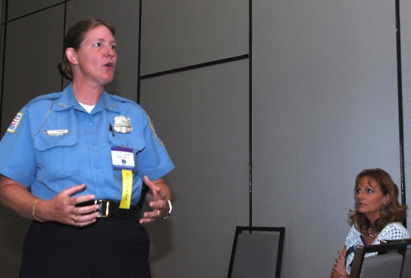 WASHINGTON -- Tech. Sgt. Susan Mayer, 459th Air Refueling Wing Military Equal Opportunity Office, briefs women veterans from around the country at the Westin Grand Hotel here June 21. Sergeant Mayer, who is also an officer with the Metropolitan Police Department, returned from Al Udeid, United Arab Emirates, last year and has recently graduated from the police academy. (U.S. Air Force photo/Tech. Sgt. Amaani Lyle)
