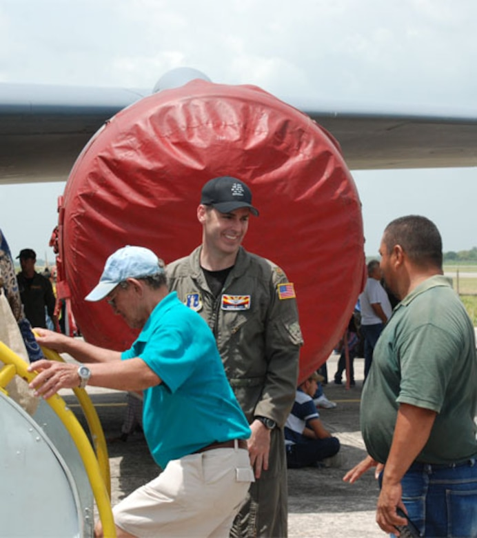 SAN PEDRO SULA, Honduras - Air Force Maj. Quinn Casey, a KC-135 Stratotanker pilot from the Arizona Air National Guard, greets visitors as they board his aircraft for a tour of the static display here June 21.  Airmen from 12th Air Force at Davis-Monthan Air Base, Ariz., coordinated the displays of two Air Force Reserve F-16s and the ANG KC-135, bringing the support of the total force to the event, which was expected to draw more than 20,000 visitors.  (U.S. Air Force photo by 1st Lt. Erika Yepsen)