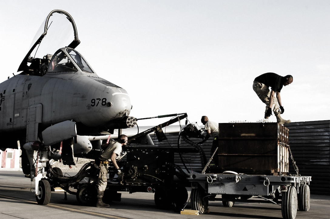 """Members of the 455th Expeditionary Aircraft Maintenance Squadron load foot-long 30 mm ammunition on an A-10 Thunderbolt II before a combat mission. The """"hog""""s' GAU-8/A seven-barrel Gatling gun is the business end of the Air Force's premier ground-attack fighter, which has been in the Air Force inventory since October 1975. (U.S. Air Force photo by Master Sgt. Demetrius Lester)"""