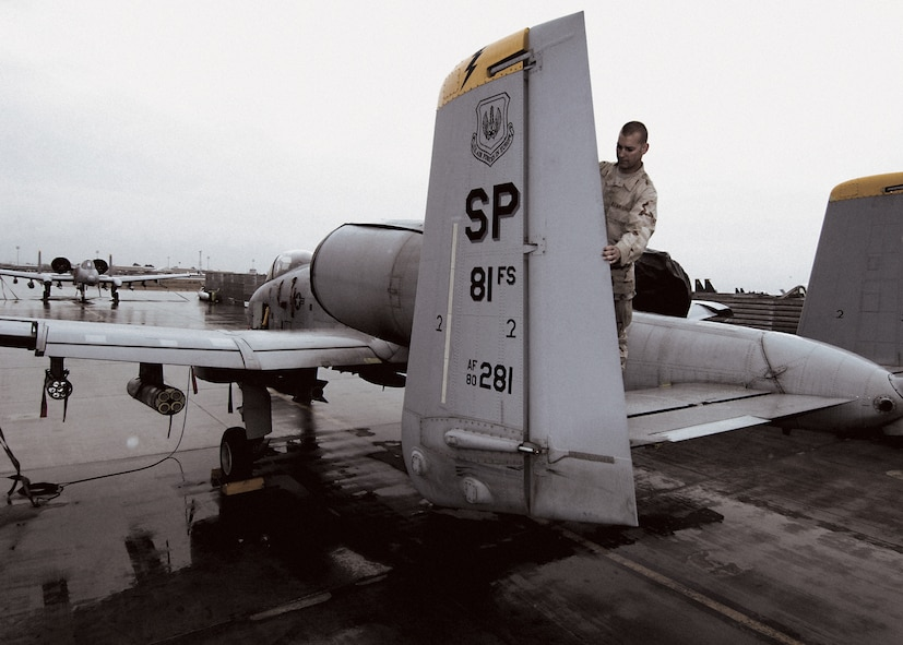 Crew chief Airman 1st Class Sean Story inspects the rudder of the oldest A-10 Thunderbolt II in U.S. Air Forces in Europe, in service since 1980.(U.S. Air Force photo by Master Sgt. Demetrius Lester)
