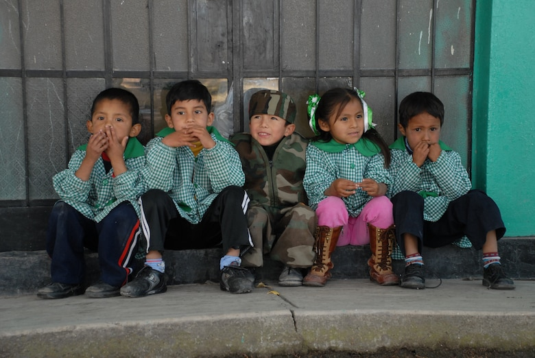 Peruvian children, from I.E. Inicial CRL. Miguel Peñarrieta Elementary School in Los Cabitos, Peru, eagerly await the beginning of recess after their tour of a U.S. CH-47 Chinook helicopter currently assigned to Task Force New Horizons. (U.S. Air Force photo/Airman 1st Class Tracie Forte)