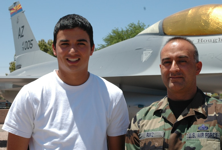 Erik Ruiz and his father, Master Sgt. Ben Ruiz, check out an F-16 static display in the 162nd Fighter Wing air park. Sergeant Ruiz is an avionics technician with 22 years of experience at the wing. Erik is currently a freshman at the Air Force Academy pursuing his dream to become a fighter pilot. (Air National Guard Photo by Capt. Gabe Johnson)