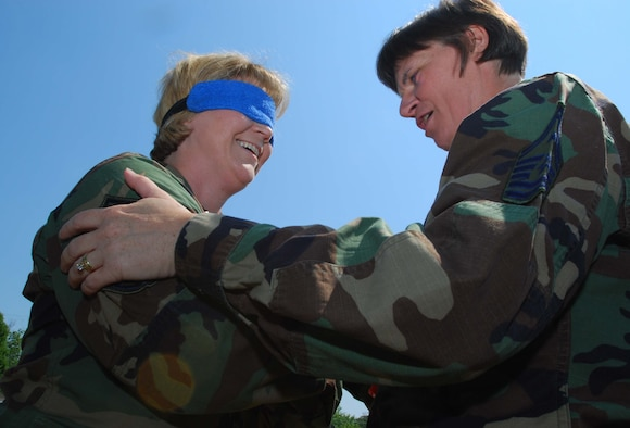 ANDREWS AIR FORCE BASE, Md. -- Senior Master Sgt. Sonja Kelley-Owens, 459th Mission Support Flight, braces as facilitator Senior Master Sgt. Sandra Dye, 72nd Air Refueling Squadron first sergeant from Grissom Air Reserve Base, Ind., primes to release her from a blindfolded freefall into the arms of her fellow classmates during the Air Force Reserve Command Senior Non-Commissioned Officer Leadership Course here June 21. The interactive two-day course consisted of group discussions, trust exercises, and techniques to enhance communication with commanders and subordinates. (U.S. Air Force photo/Tech. Sgt. Amaani Lyle)