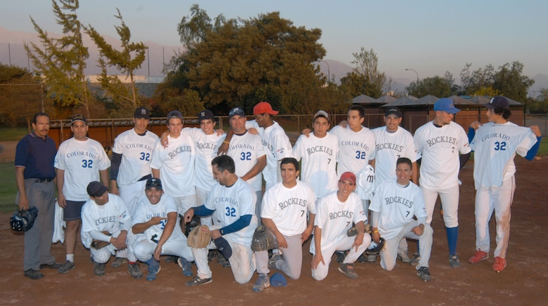 The Santiago Metros semi-pro baseball team poses proudly in their new Colorado Rockies tee shirts, after trouncing the visiting U.S. Airmen 8 to 5 in a friendly display of baseball diplomacy. Airmen stationed at Davis-Monthan Air Force Base and 12th Air Force (Air Forces Southern) worked with the Rockies to get donations of tee shirts, backpacks and hats for not only the Chilean team but the local children in Santiago. The Airmen were taking part in FIDAE 2008, one of the largest air and trade shows. (U.S. Air Force photo/Master Sgt. Jason Tudor).