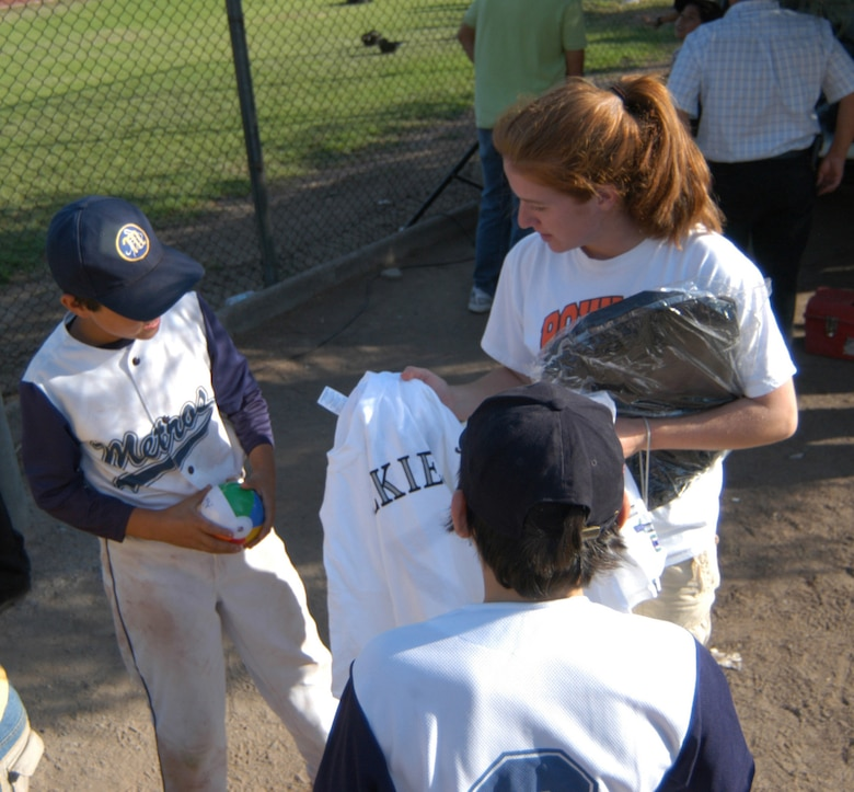 A U.S. Airman gives out tee shirts and backpacks, donated by the Colorado Rockies professional baseball team, to the members of the Santiago Metros semi-pro team. The Airmen were in Chile for FIDAE 2008, one of the largest air and trade shows in the world, as well as Exercise Newen. U.S. Southern Command will continue the cameraderie later this year as they launch a baseball diplomacy tour. (U.S. Air Force photo/Master Sgt. Jason Tudor).