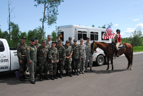 E'leese Madgett Manrique, 12 years old, stops at the 148th Fighter Wing, Duluth, Minn. to meet with wing members on June 23, 2008.  E'leese is riding her horse across Minn. trying to raise $15 million to start a ranch for veterans and military members.  (U.S. Air Force photo by Tech. Sgt. Jason W. Rolfe)  (Released)