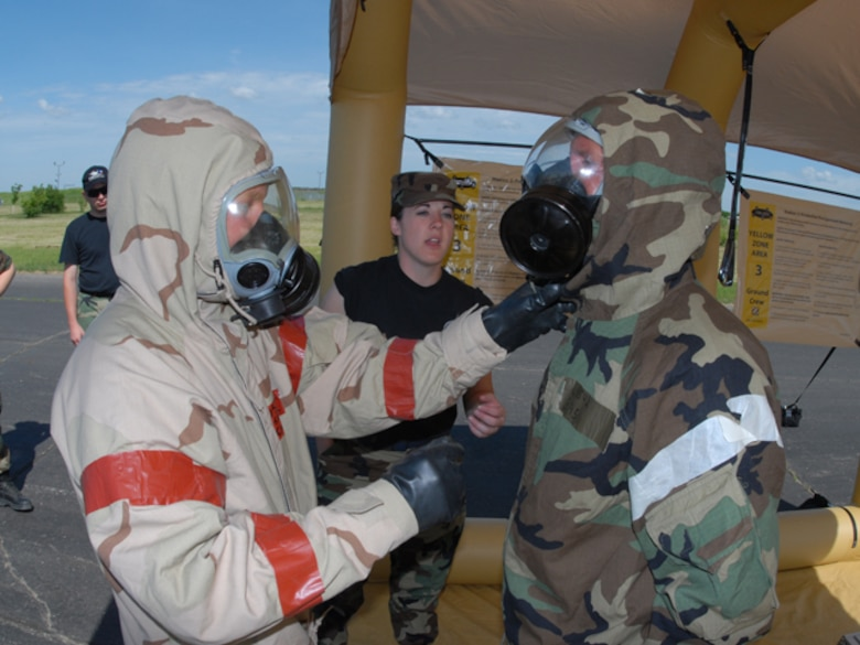 Airmen go through a decontamination line at the 119th Wing, N.D. Air National Guard during Emergency Management Training in Fargo on Monday, June 23, 2008.  Photo taken by SMSgt David Lipp, 119th Wing.