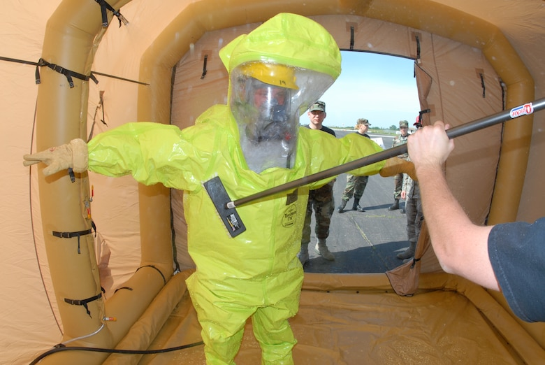 Airmen go through decontamination procedures during Emergency Management Training hosted at the 119th Wing, N.D. Air National Guard on Monday, June 23, 2008.    Photo taken by SMSgt David Lipp, 119th Wing