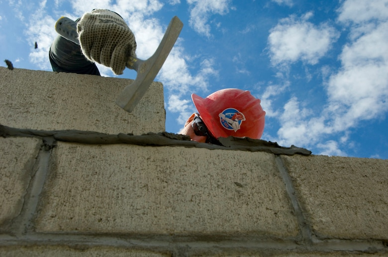 Senior Airman Russell Smith hammers a cinder block into position for the building of a medical clinic in Yanama, Peru, June 23 during New Horizons-Peru 2008, a U.S. and Peruvian partnered humanitarian mission set on providing relief to underprivileged Peruvians. Airman Smith is a member of the 820th RED HORSE Squadron at  Nellis Air Force Base, Nev. (U.S. Air Force photo/Staff Sgt. Bennie J. Davis III)