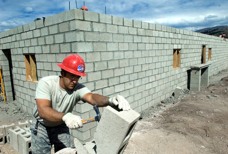 Tech. Sgt. Devan Chuvnoski prepares cinder blocks for the building of a medical clinic in Yanama, Peru, June 23 during New Horizons-Peru 2008, a U.S. and Peruvian partnered humanitarian mission set on providing relief to underprivileged Peruvians. Sergeant Chuvnoski is a civil engineer with the 820th RED HORSE Squadron at Nellis Air Force Base, Nev. (U.S. Air Force photo/Staff Sgt. Bennie J. Davis III)