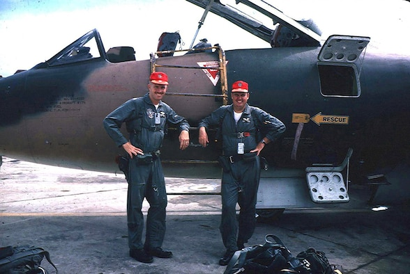 WHITEMAN AIR FORCE BASE, Mo., -- Capt. Bob Butterfield (left) and his navigator, Capt. Hugh Davidson, pose in front of their 13th Bomb Squadron B-57 after flying a mission in Vietnam. (U.S. Air Force courtesy photo)