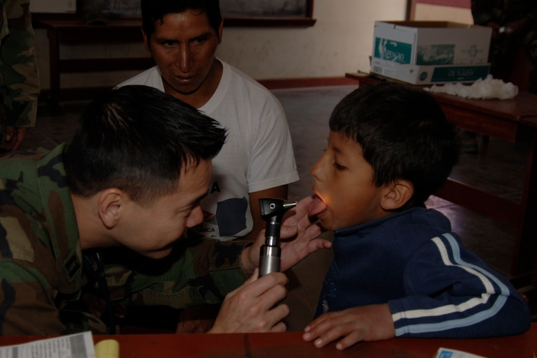 U.S. Air Force Capt. Truong Quach, a doctor assigned to Task Force New Horizons, treats a Peruvian boy, June 26, during a medical mission supporting New Horizons Peru - 2008, a U.S. and Peruvian humanitarian effort to provide relief to underprivileged Peruvians. (U.S. Air Force photo / by Tech. Sgt. Kerry Jackson)