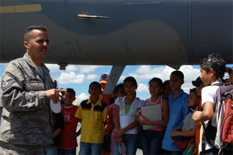 Master Sgt. Carlos Rivera, an F-15 crew chief with the 33rd Fighter Wing, gives a Spanish language tour of the F-15C Eagle for children of Fundaci?n El Man?, a local charitable organization focused on assisting disadvantaged children, at the RIO NEGRO air and trade show near Medellin Colombia.  Children from the non-profit organization, toured military aircraft before watching the F-15 West Coast Demonstration Team perform.  Afterwards, members of the team signed autographs and took photos with the VIP guests. (Photo by Capt. Nathan Broshear)