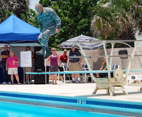 Look, up in the sky .... it's a bird, it's a plane ..it's Command Chief Master Sgt. Dennis Vannorsdall taking a dive during the Annual Junior Enlisted Picnic. (U.S. Air Force photo by Chris Kraus).