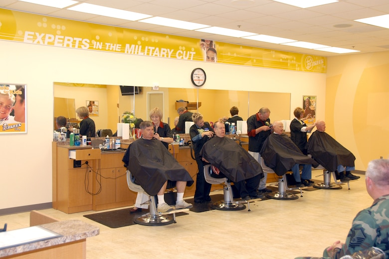 Team Offutt members enjoy the larger barber shop in the base exchange mall. The mall area includes a larger food court, clothing sales, GNC and more.  (U.S. Air Force Photo By/Jeff Gates)